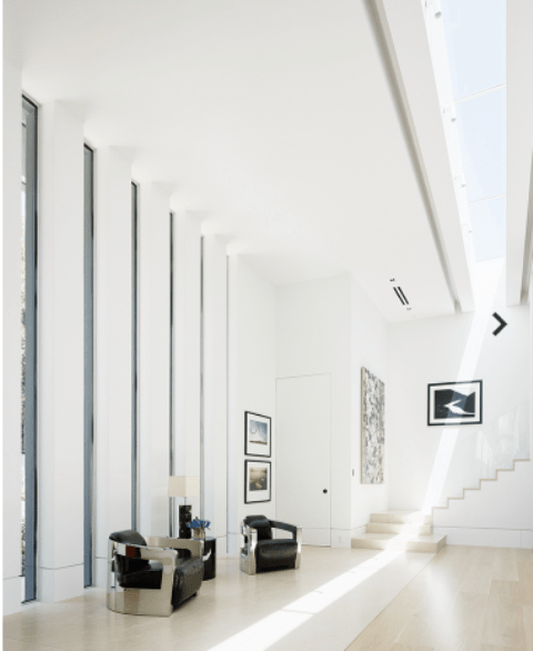 16ft windows and a skylight create drama and natural light
