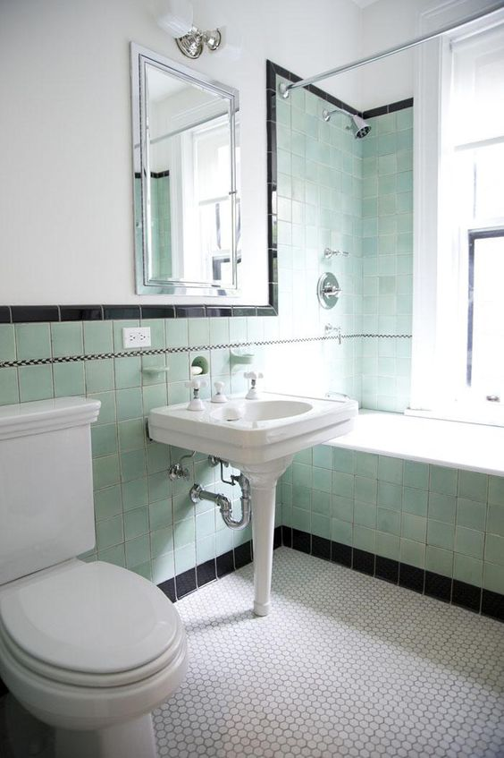 accentuating black border tiles on the bathroom walls