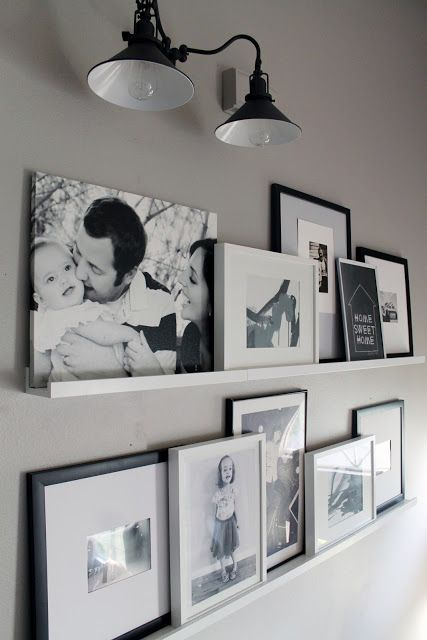 black and white photo gallery wall on Ribba ledges
