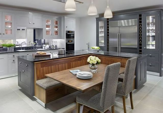 kitchen island that is combined with a fully functional seating area with a  table