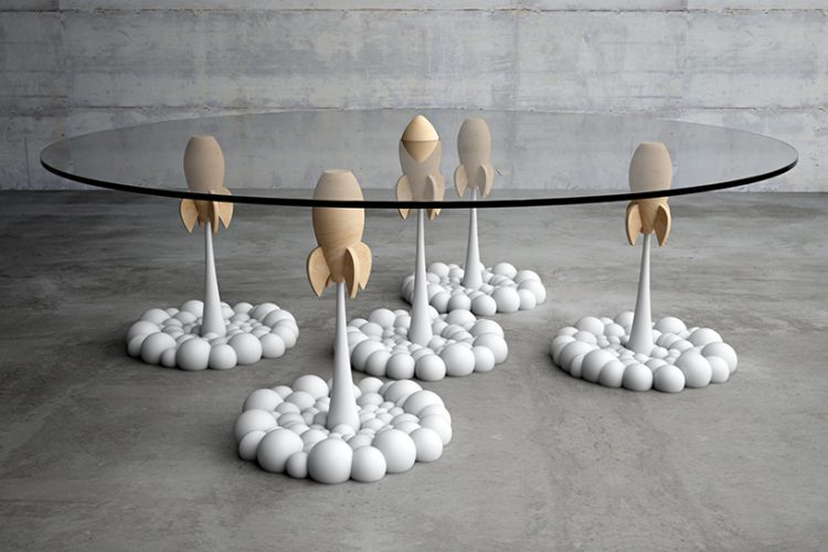 the Rocket table brings fluffy, cartoon-like clouds and aerial rockets from a personal toy collection to life