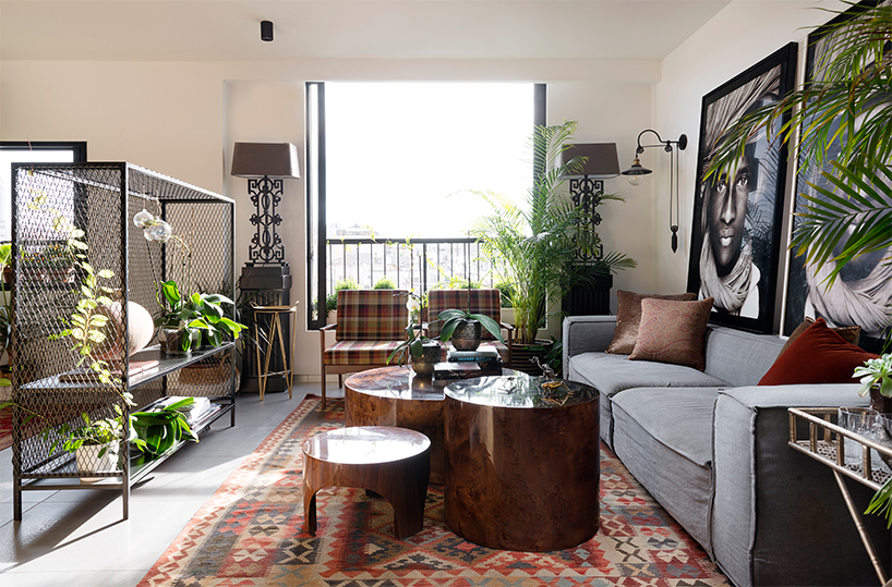 the living room is decorated with slight boho touches