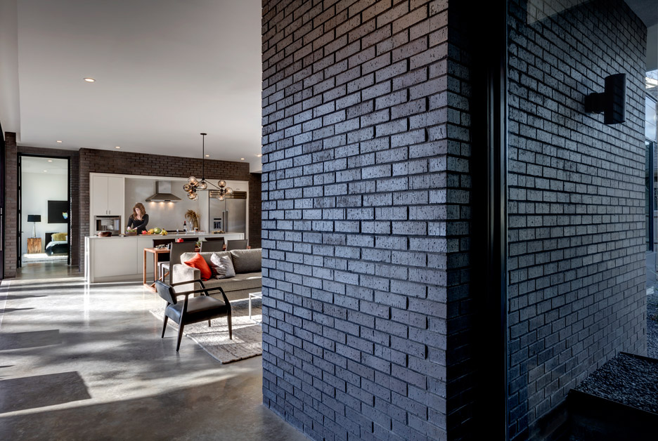 black brick clad adds drama to the decor