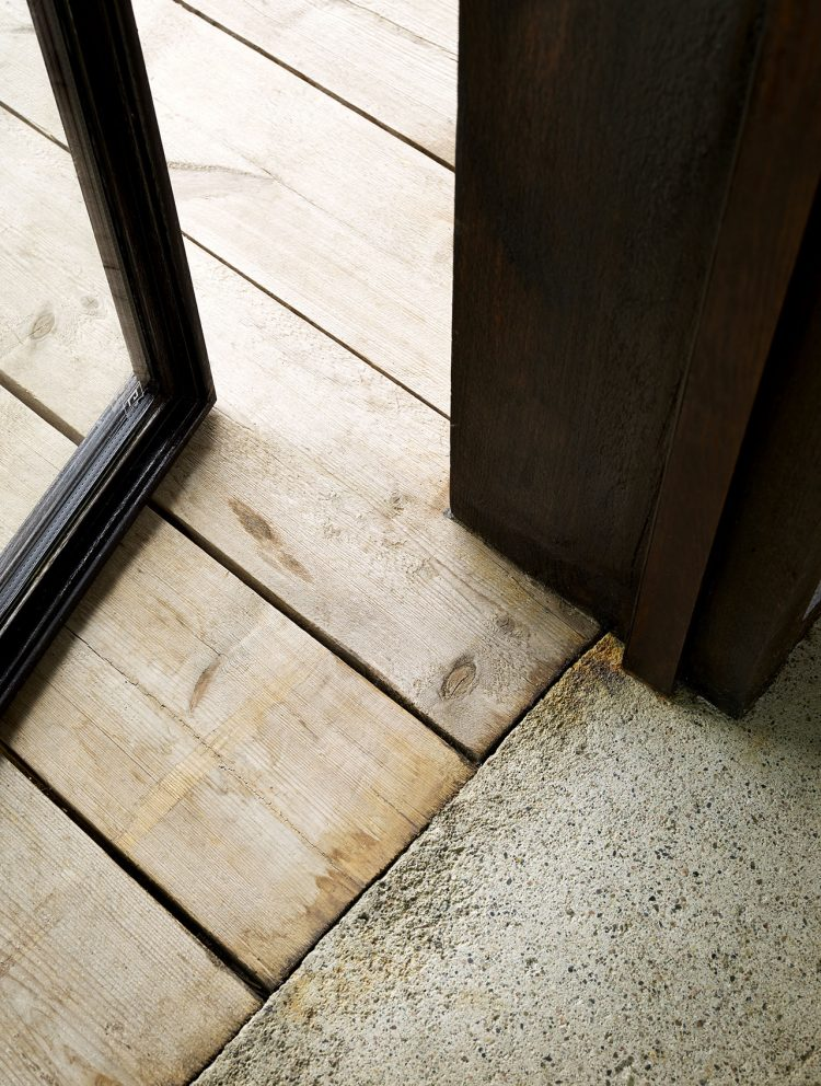 concrete floors inside and a wooden deck outside