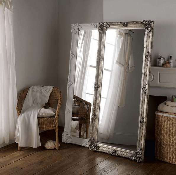 two tall mirrors create one more dimansion in your bedroom