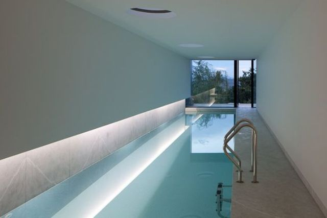 Modern Indoor Narrow Pool With Lighting And A View