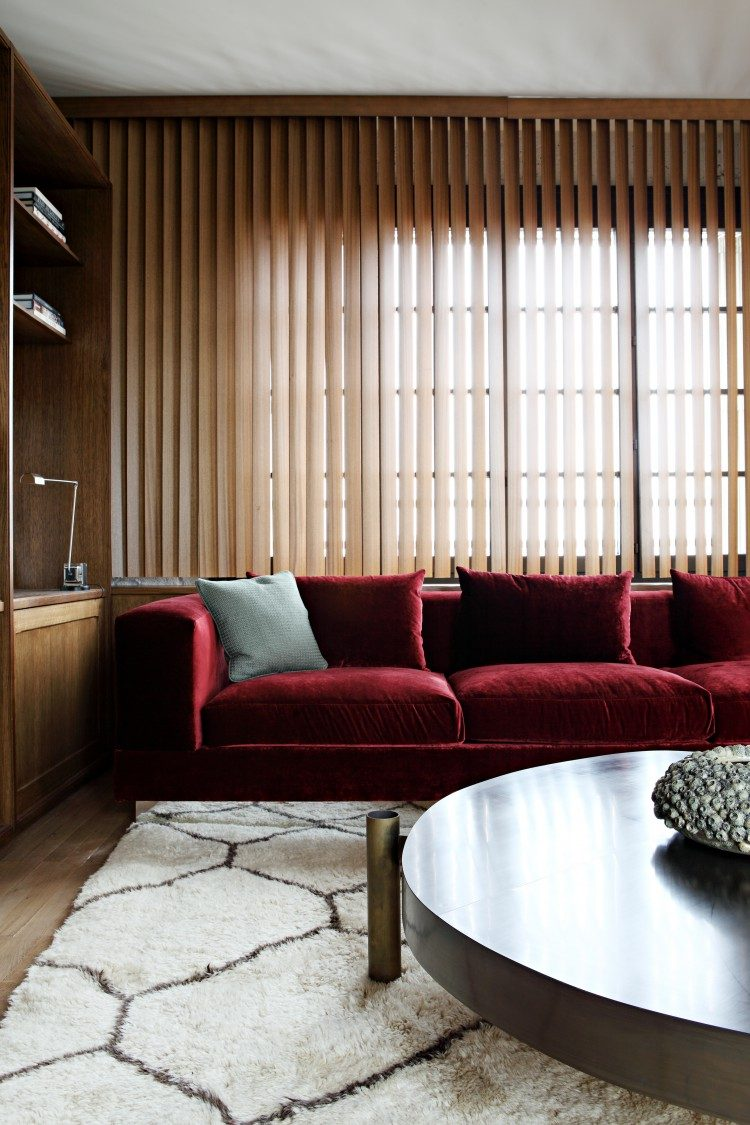 neutral living room with a bold red sofa