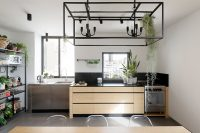 06 a custom-made wooden unit made of bamboo has a contrasting black marble surface