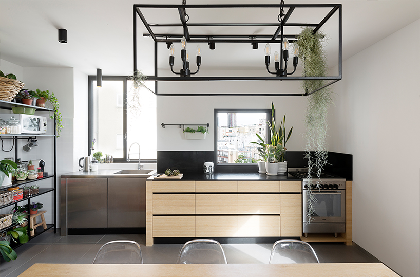 a custom made wooden unit made of bamboo has a contrasting black marble surface