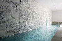 06 luxurious marble clad indoor pool