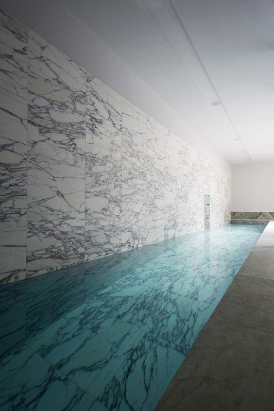 luxurious marble clad indoor pool