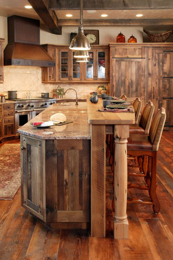 rustic kitchen clad with warm-colored wood