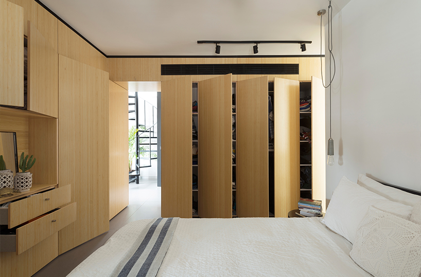 a concealed door in the same large closet leads into the master bedroom