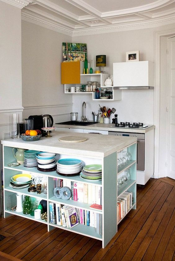 kitchen island with book and dishes storage