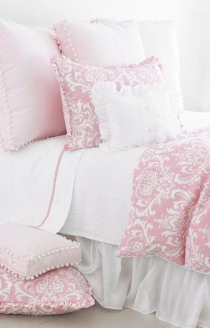 pink printed bedding with pompoms