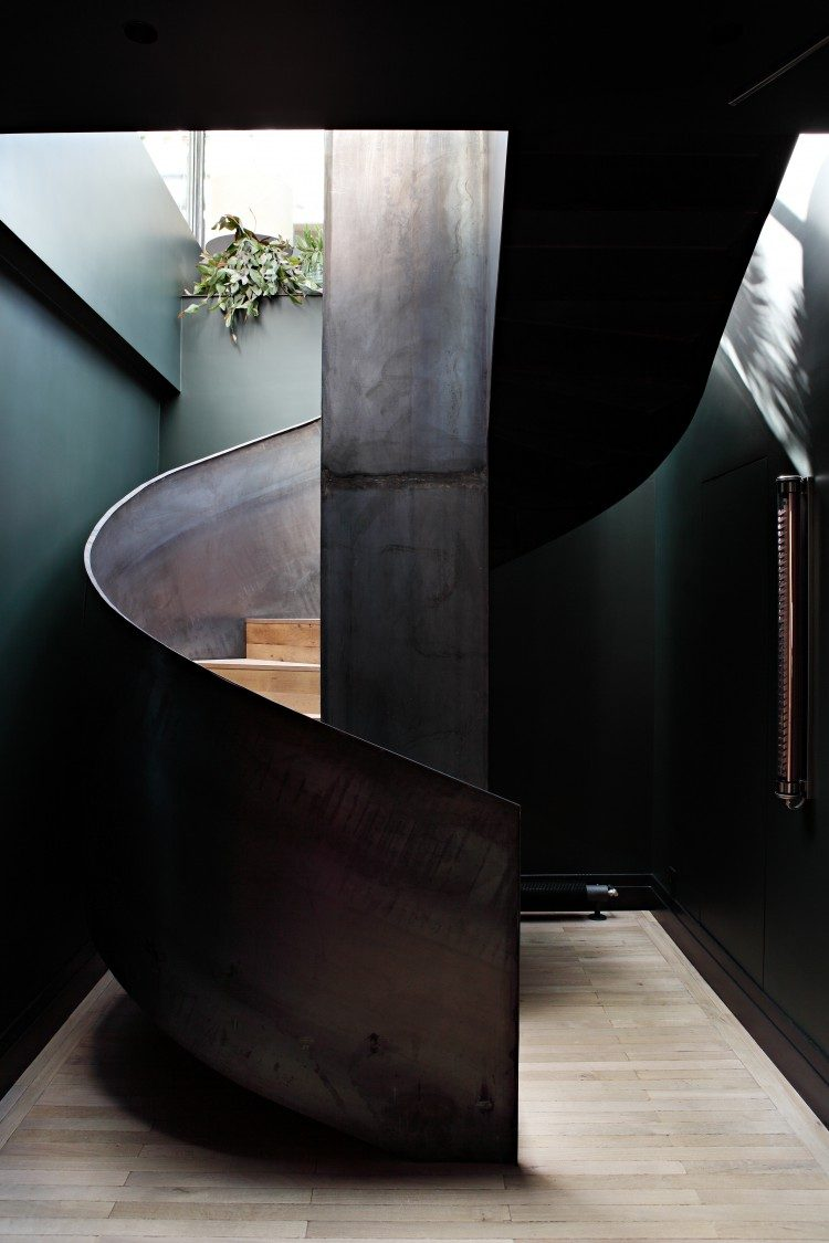 sculptural rough metal staircase makes a statement