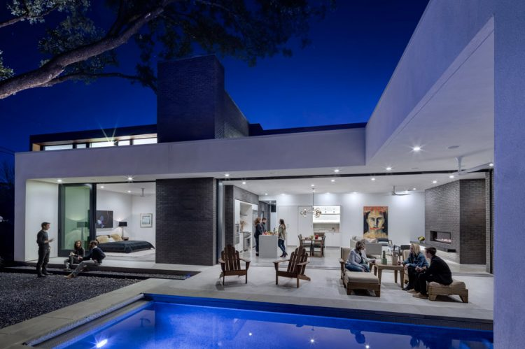 the poolside area becomes an outdoor family room