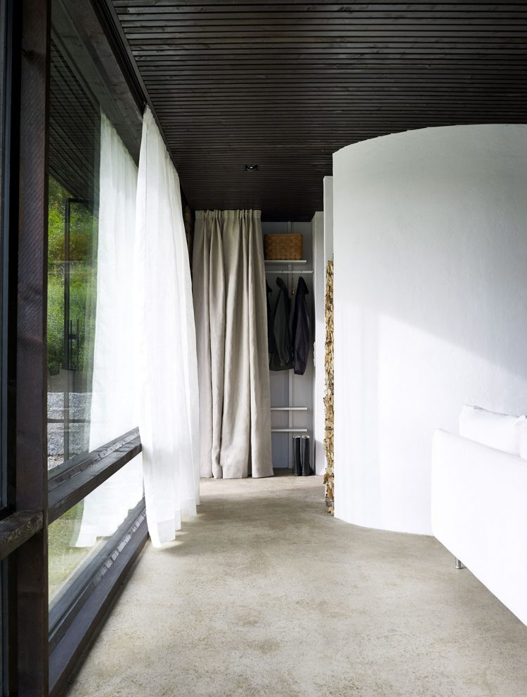 The draperies hide what's not necessary at the moment, and the woode stack makes the space look cozier and warmer.