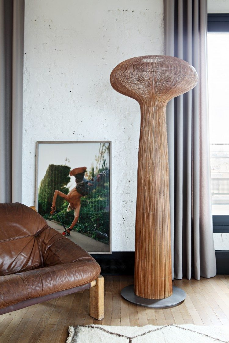 a unique floor lamp makes a statement in the living room