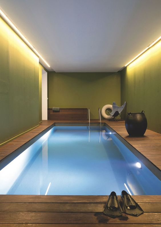 modern simple indoor pool with a wooden deck around