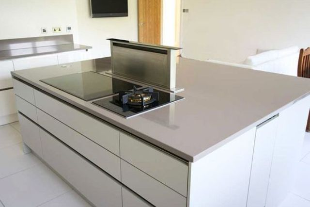Minimalist Kitchen Island With A Built In Cook Top