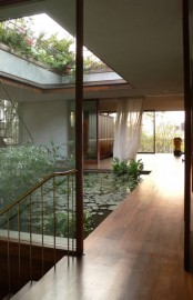 An Indoor Courtyard With A Pond