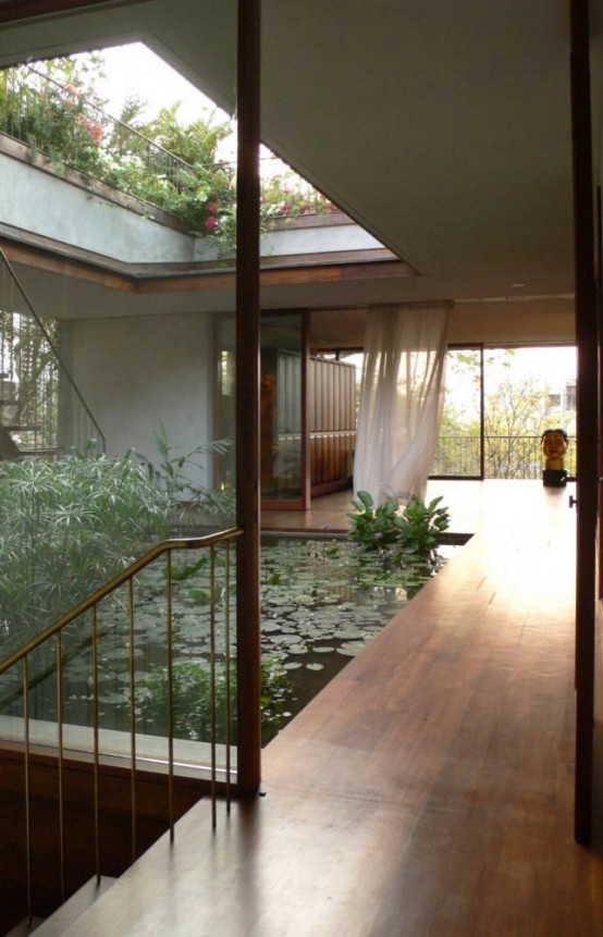 An Indoor Courtyard With A Pond (via home-designing)
