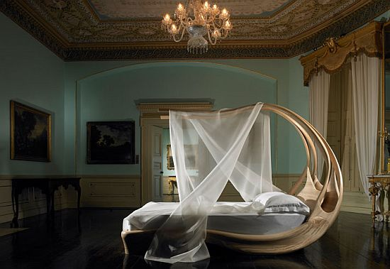A Bedroom With An Extravagant Canopy Bed (via bornrich)