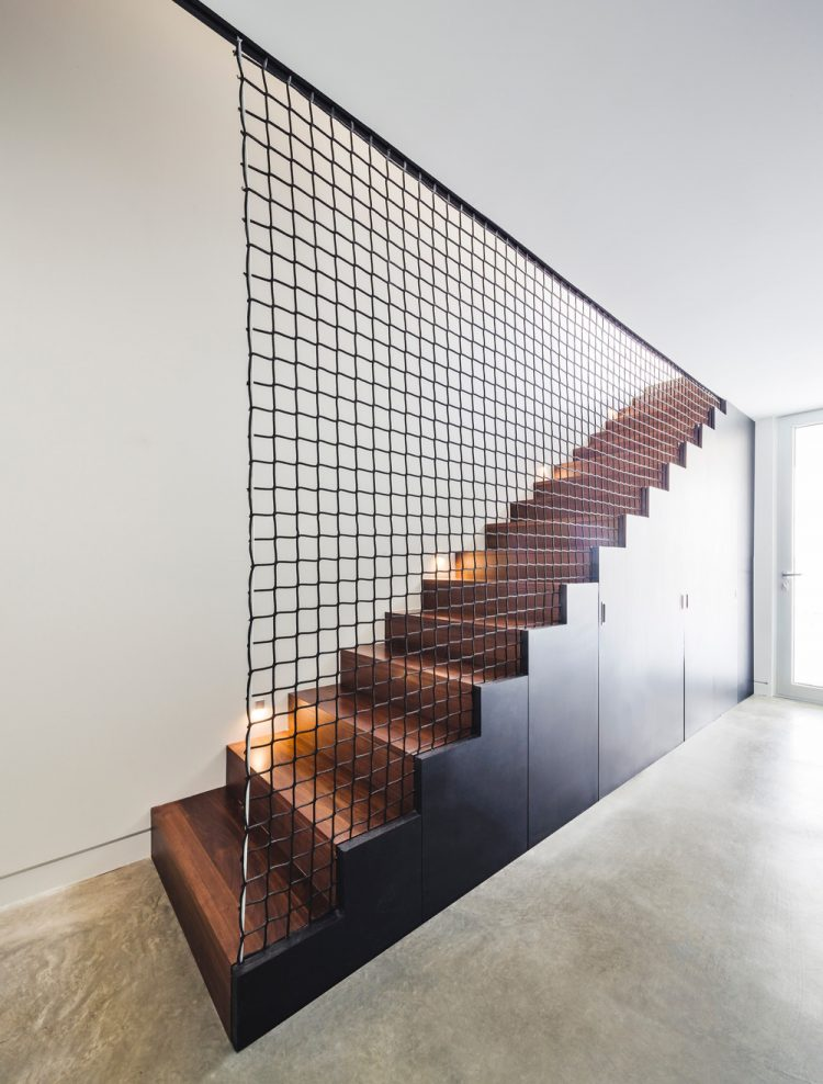 A net over the staircase is an interesting solution to divide the space