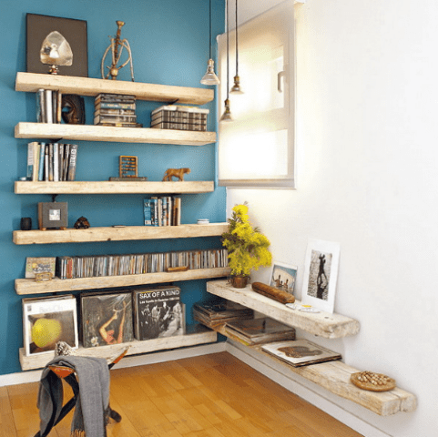 light blue accent wall with shelves and accessories
