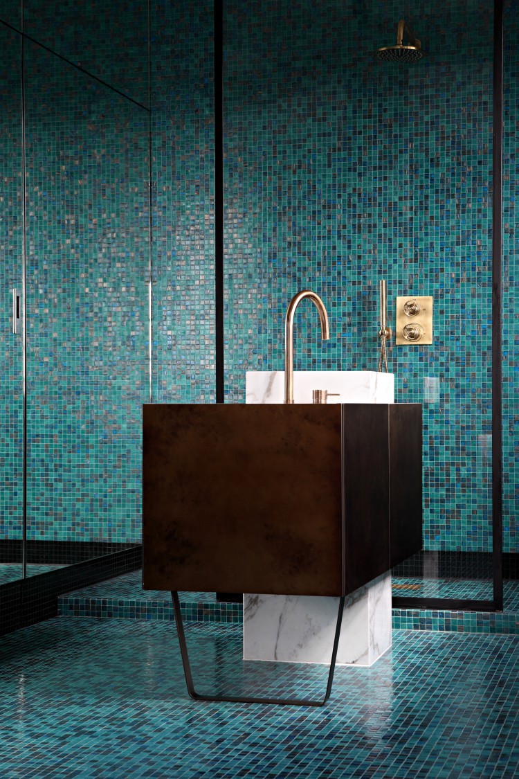 mosaic bathroom tiles contrast with a metal sink stand