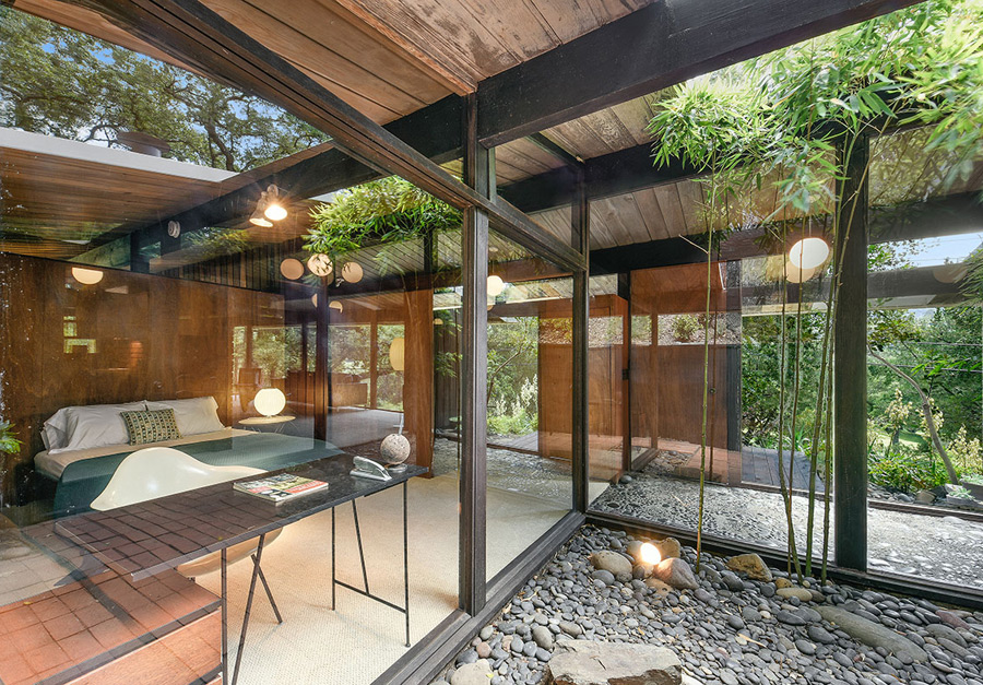 the unusual flat roof design with 'holes' lets a lot of light in