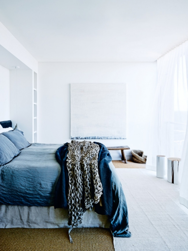 The master bedroom is soothing in washed-out blue shades