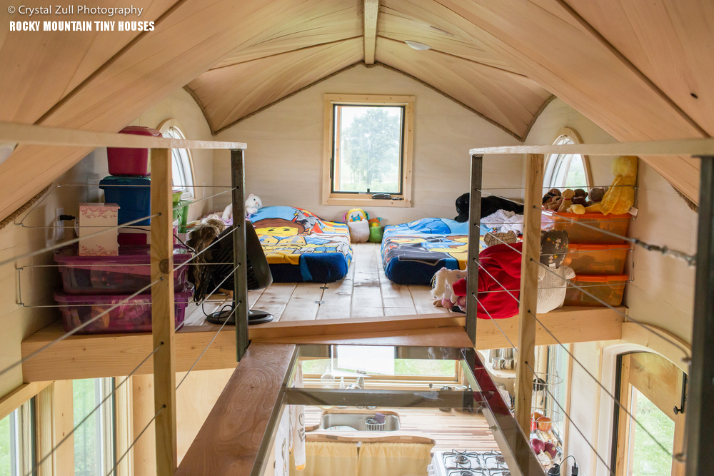 cool tiny house on wheels with bedrooms for four digsdigs 20868 | 12 theres a shared kids bedroom with some open storage