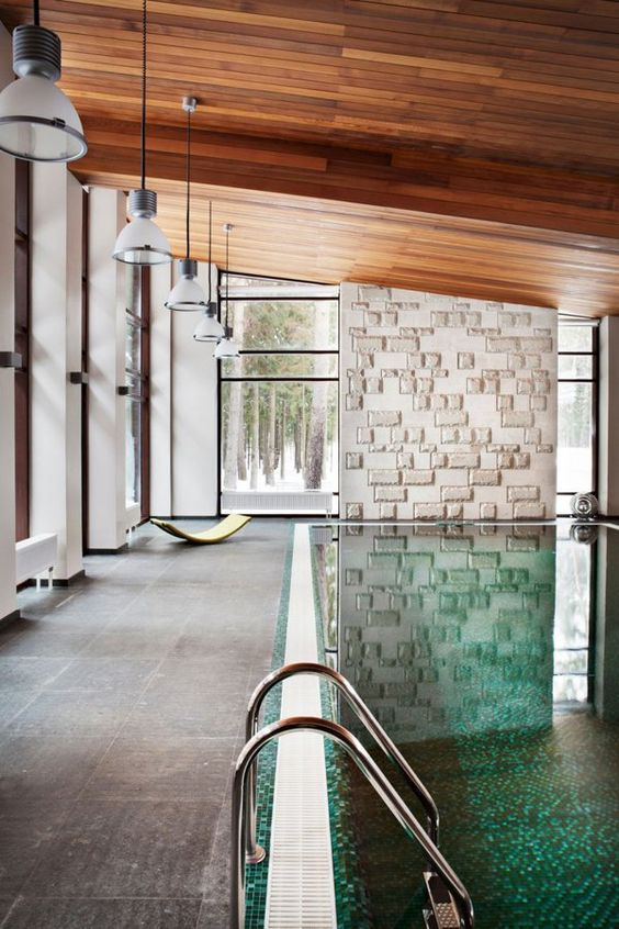 amazing modern indoor swimming pool with a tiled deck