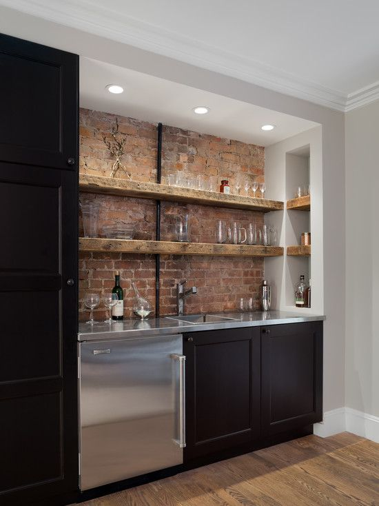 basement bar with a brick backsplash and open shelving