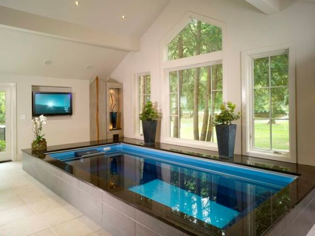 endless indoor pool in a home spa