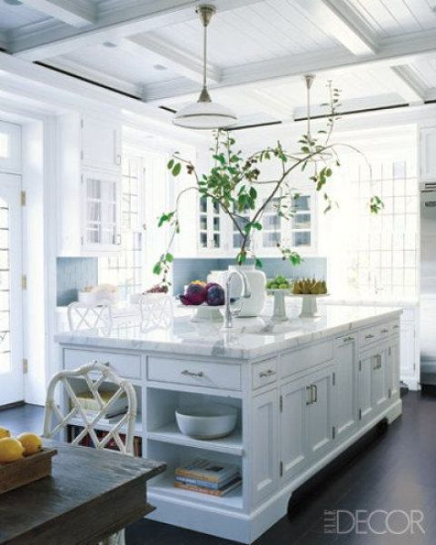 kitchen island with tableware and book storage