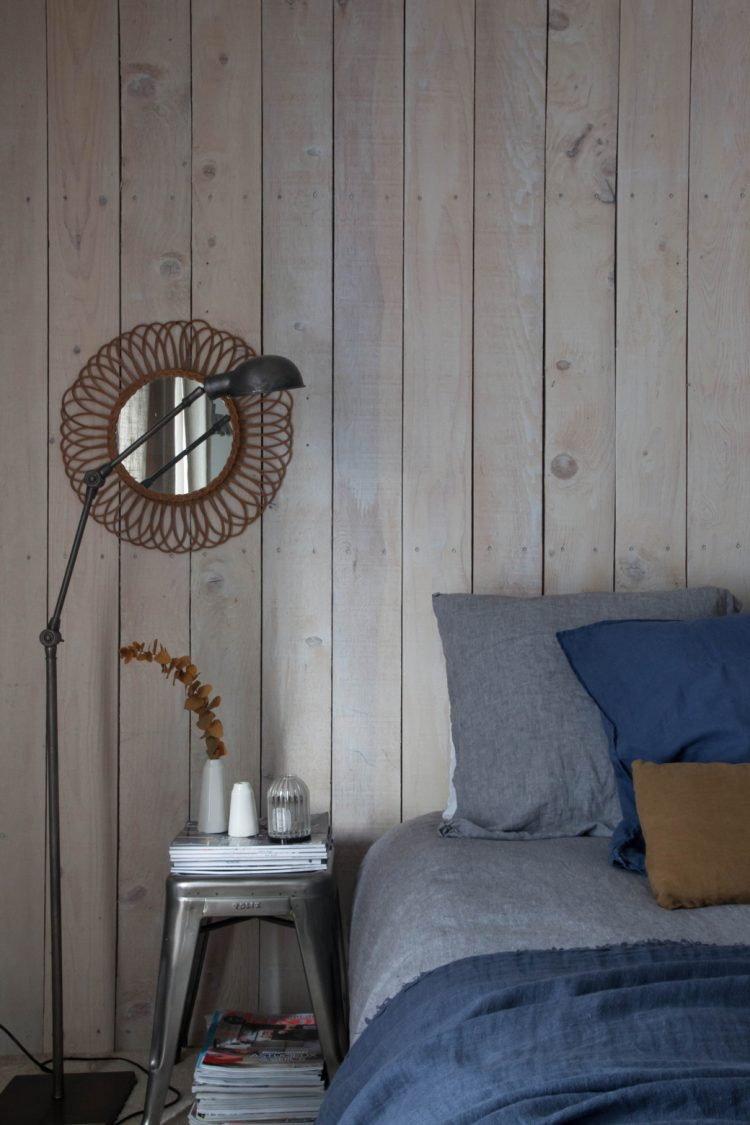 the master bedroom is full of rustic and industrial touches