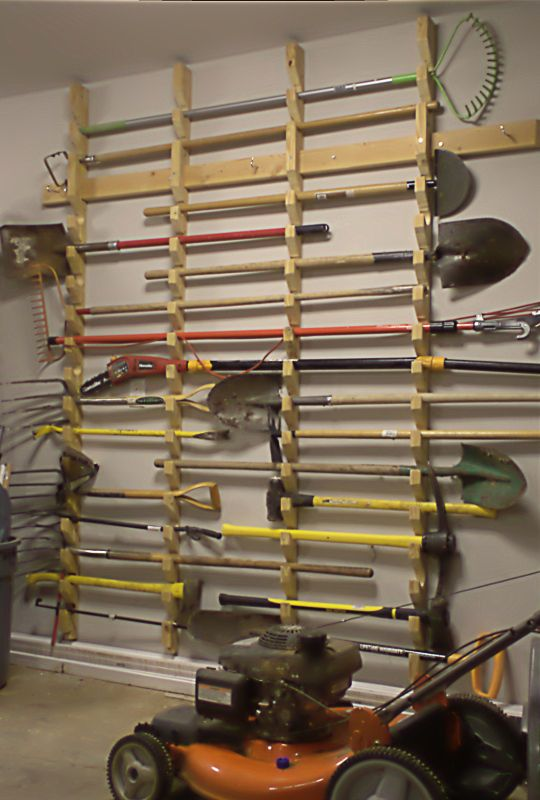 27 basement storage ideas and 8 organizing tips digsdigs for Gardening tools storage