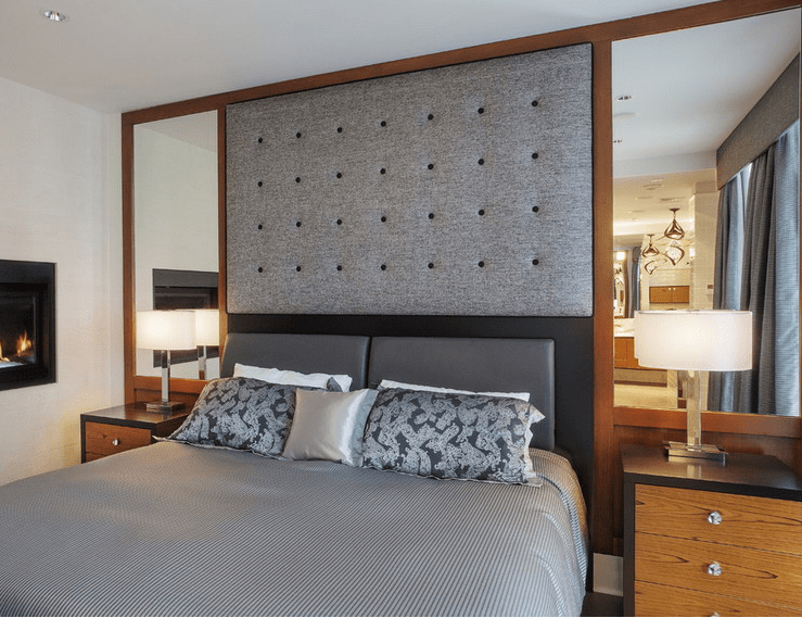Hollywood-style symmetrical mirrors with a fabric headboard