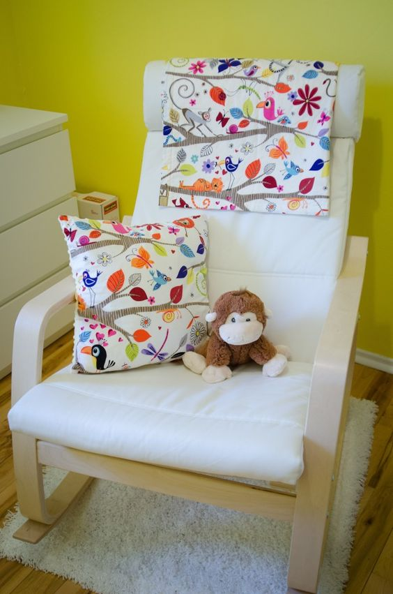 Poang chair with a floral pillow and cover