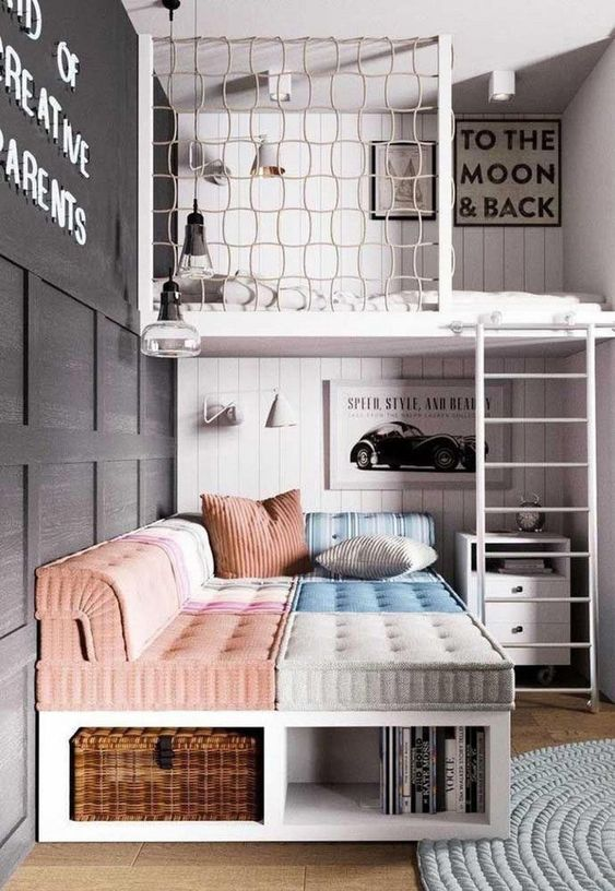 a catchy teen room with a loft bedroom, a catchy daybed with pillows, a small nightstnad and a black paneled wall