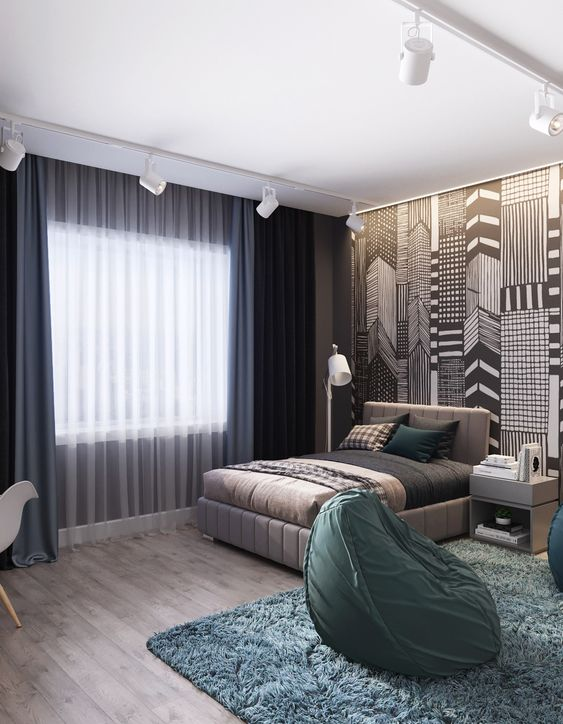 a catchy teen room with graphic wallpaper, an upholstered bed, printed textiles, green beanbag chairs and navy curtains