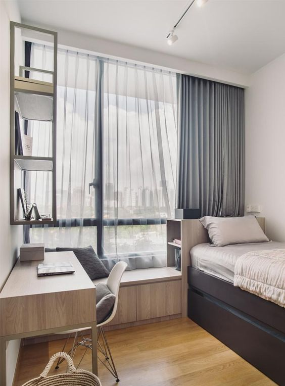 a contemporary teen room with a storage bed, a windowsill seat, a matching desk and a shelf on the wall