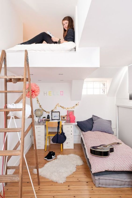 a cool teen room with a loft space for some privacy, a bed and a desk for studying and a ladder to climb up