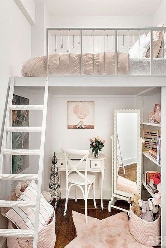 a creative Parisian teen bedroom with a loft bedroom, a tiny desk and a chair, a floor mirror and built-in shelves