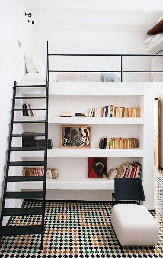 a creative teen room with a loft bedroom and closet and a reading space down with built in shelves and an ottoman