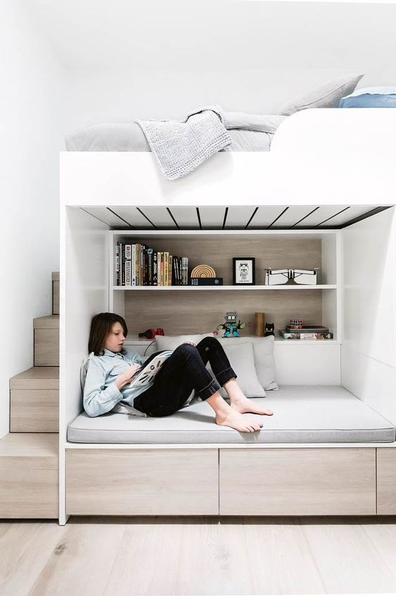 a minimalist teen room with a loft bedroom and a study and reading space down, with storage and built-in shelves is great