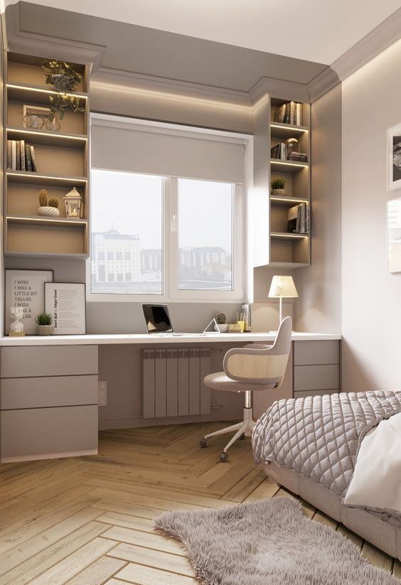 a stylish neutral teen bedroom with an upholstered bed, a study space by the window including drawers and open storage compartments plus a chair